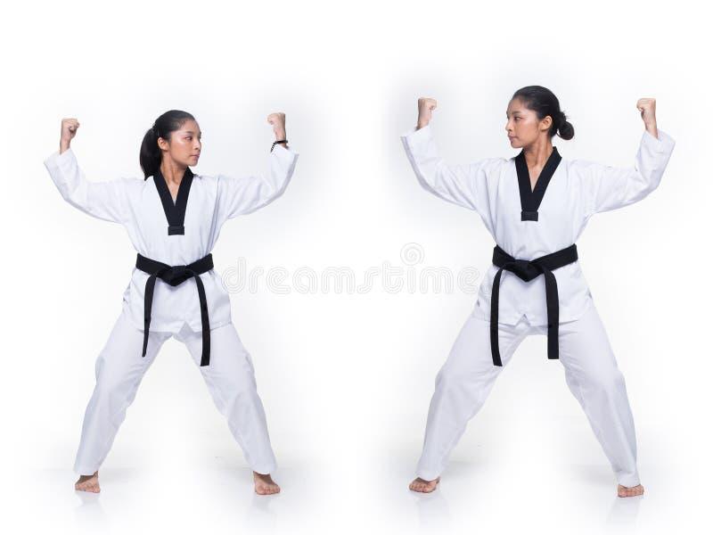 Ato de combate do professor mestre de TaeKwonDo do cintur?o negro foto de stock