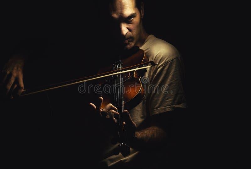 Ato de um jogador do violino fotografia de stock royalty free