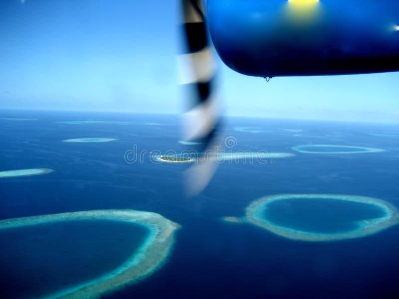 Atolls e seaplane imagem de stock royalty free