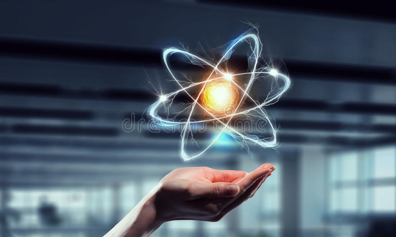 Atom ikona w palmie Mieszani środki Mieszani środki zdjęcie stock