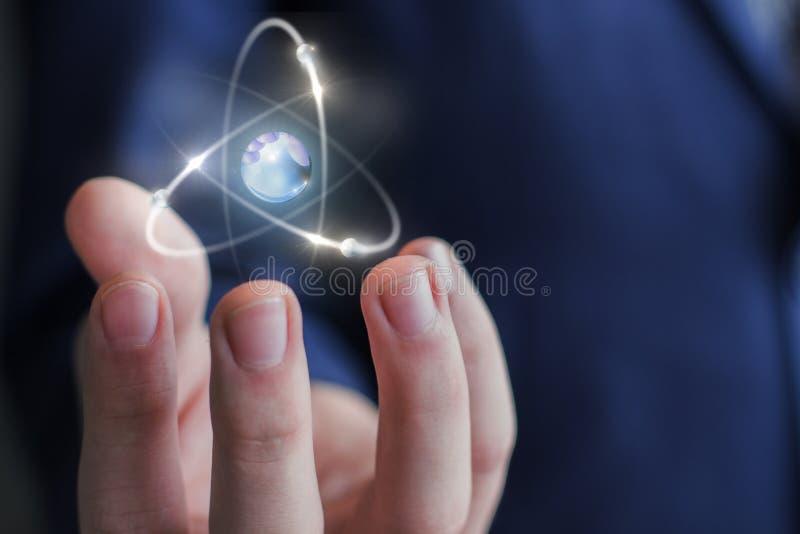 Atom w ręce zdjęcia stock