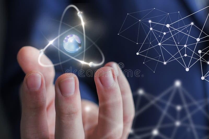 Atom w ręce obraz stock