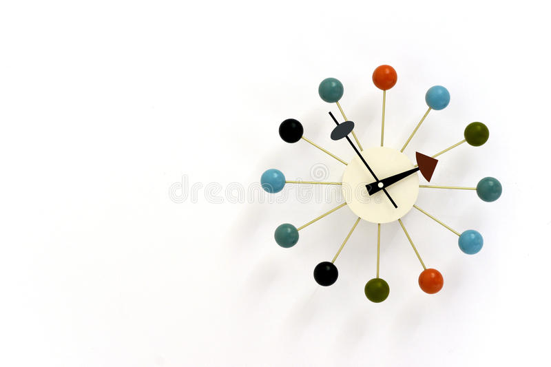 Atomic clock. Retro atomic wall clock with coloured balls around edge royalty free stock photos