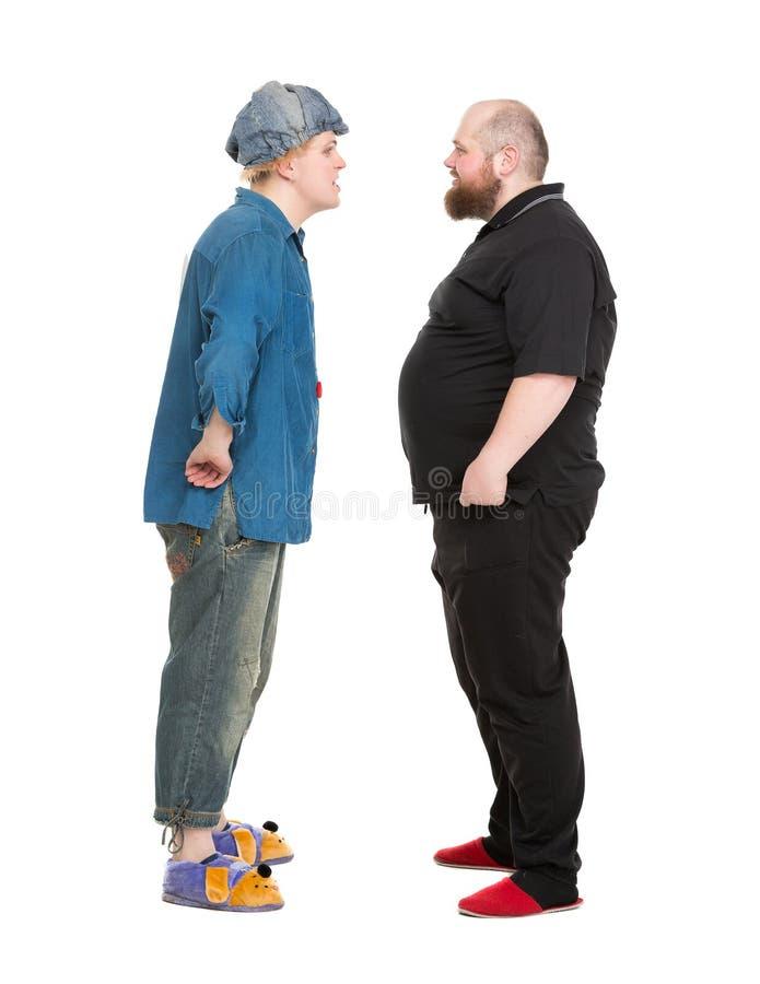 Ator Dressed como o herói do conto de fadas que fala com Fatman fotografia de stock