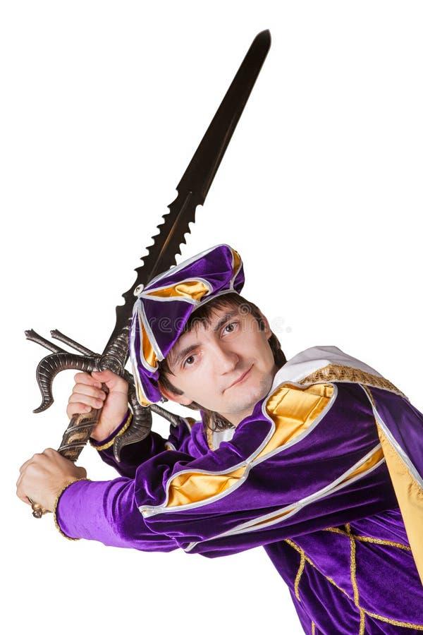 Ator em um terno do príncipe com uma espada fotografia de stock royalty free