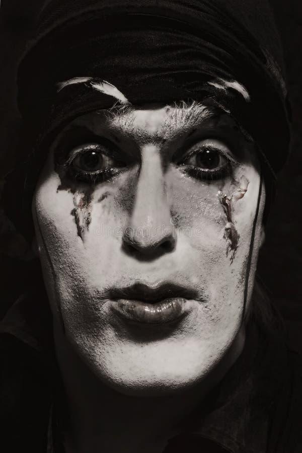 Ator teatral com composição escura foto de stock