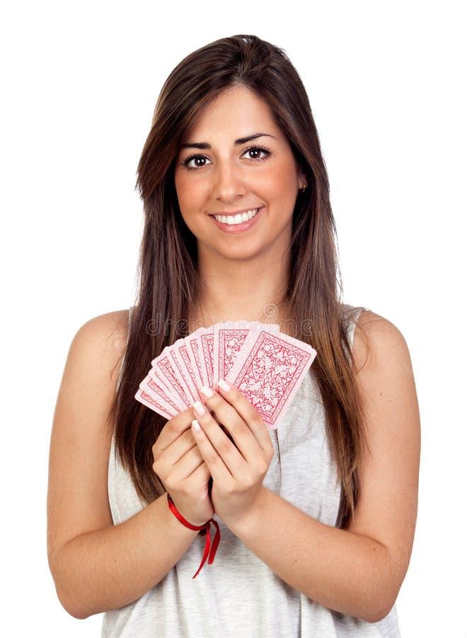 Atractive girl playing cards stock photos