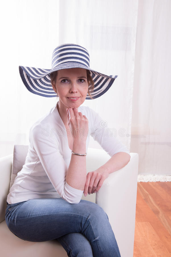 Atractive woman with blue-white hat royalty free stock photos
