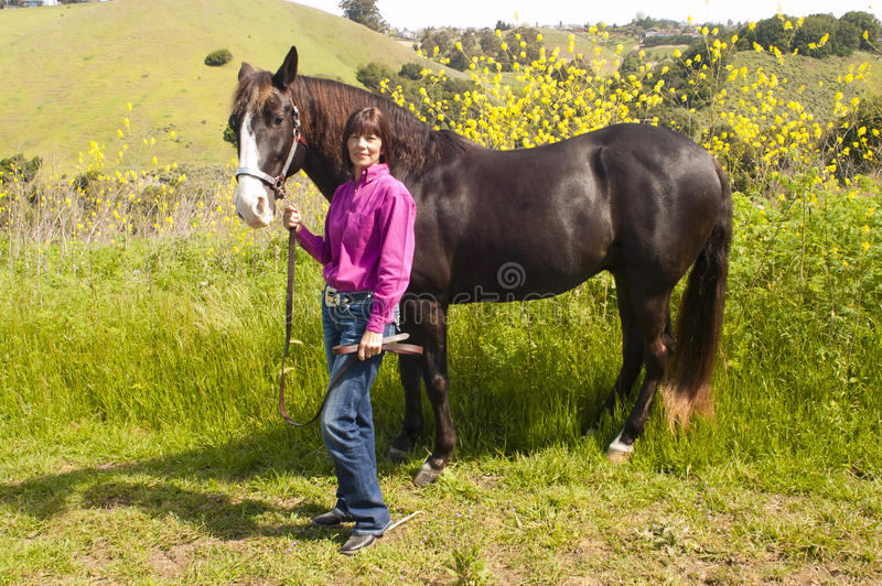 Atractive woman and horse