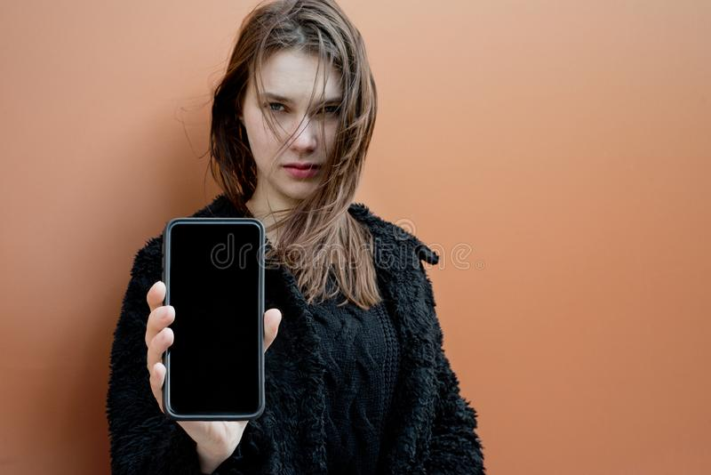 Atractive woman with smartphone with black screen royalty free stock photos