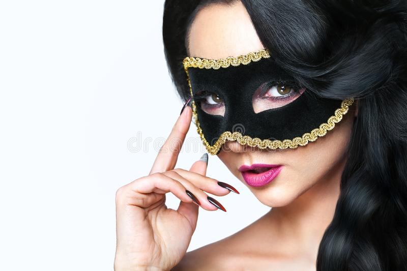 Atractive young woman with venice mask studio portrait stock images