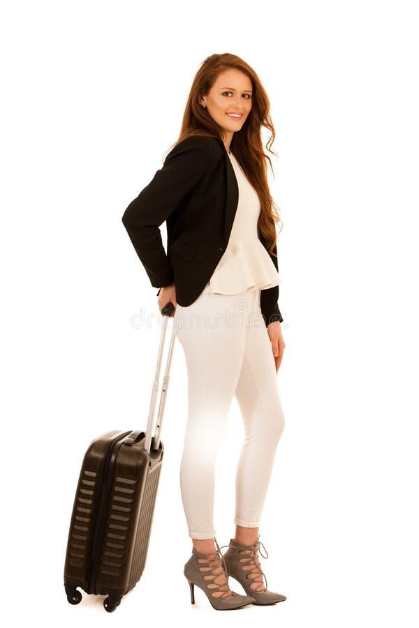 Atrakcyjna busienss kobieta z walizką - biznesowej podróży studio zdjęcia stock