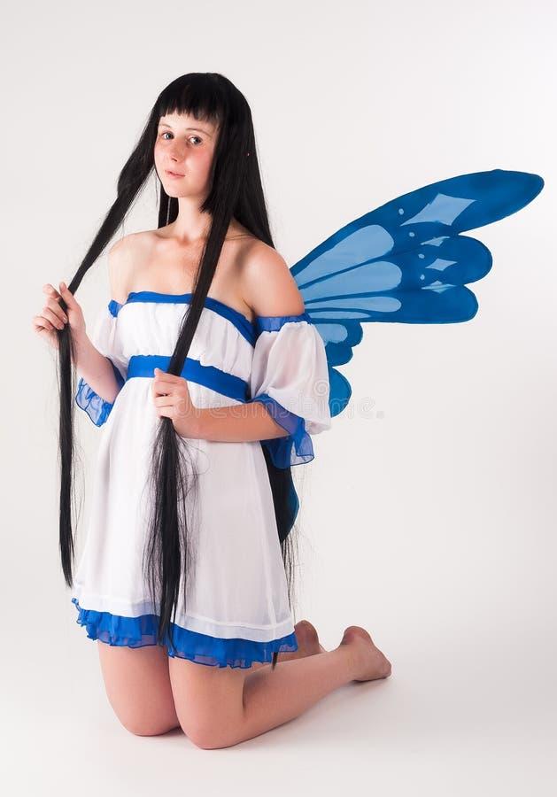 Atrakcyjna dziewczyna jako czarodziejka z skrzydłami zdjęcia royalty free