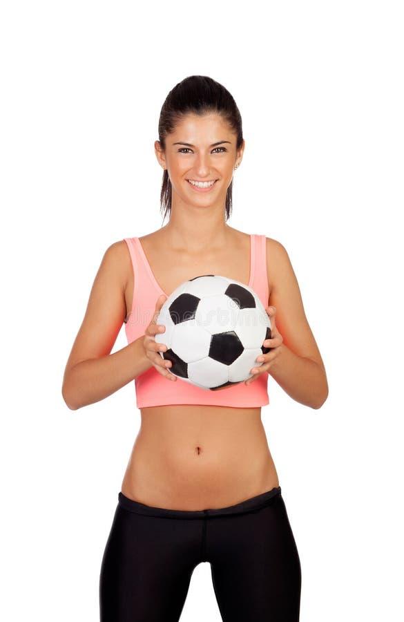 Atrakcyjna dziewczyna z piłki nożnej piłką fotografia royalty free