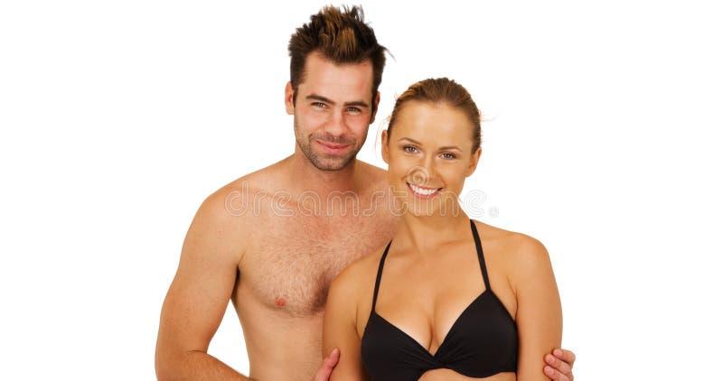 Atrakcyjna Kaukaska millennial pary pozycja przed białym tłem ono uśmiecha się przy kamerą obrazy stock