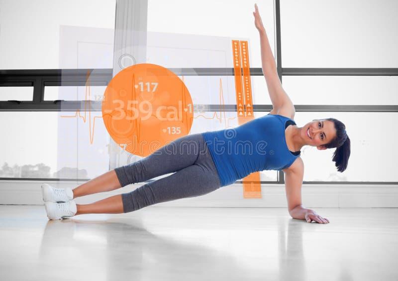 Atrakcyjna kobieta robi joga z futurystycznym interfejsem obok go royalty ilustracja
