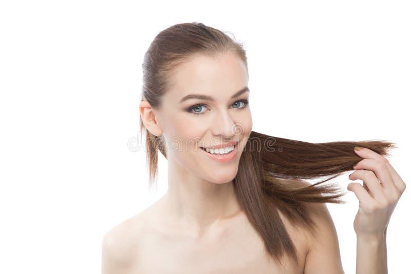 Atrakcyjna kobieta z długim gładkim włosy fotografia royalty free