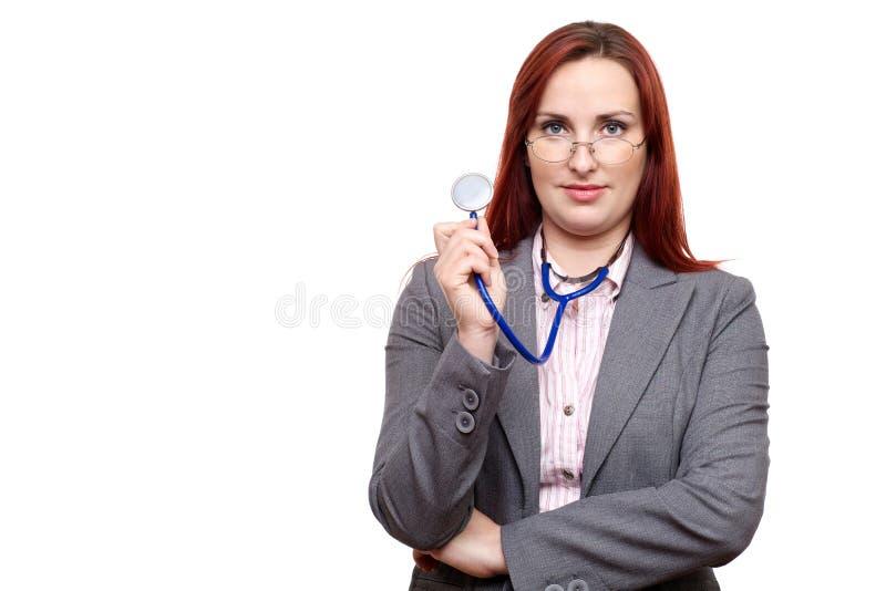 Atrakcyjna lekarka lub lekarz patrzeje nad szkłami fotografia royalty free