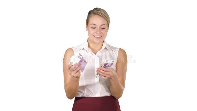 Atrakcyjna młoda kobieta ono uśmiecha się na białym tle liczy euro obraz royalty free