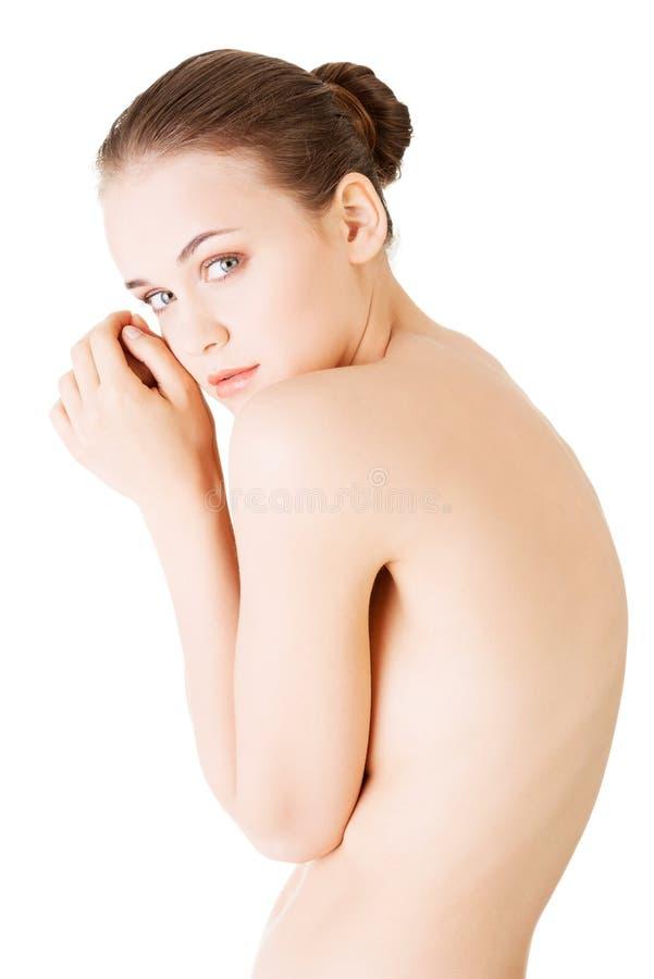 Atrakcyjna młoda naga kobieta. Boczny widok. obraz stock
