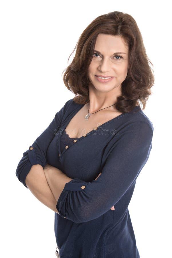 Atrakcyjna w średnim wieku kobieta odizolowywająca nad bielem zdjęcia royalty free