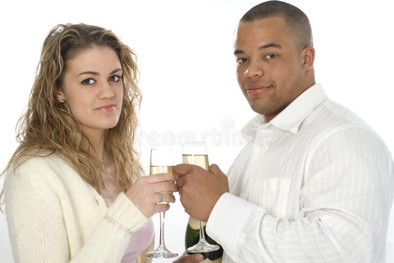 atrakcyjne szampana młodych par zdjęcie stock