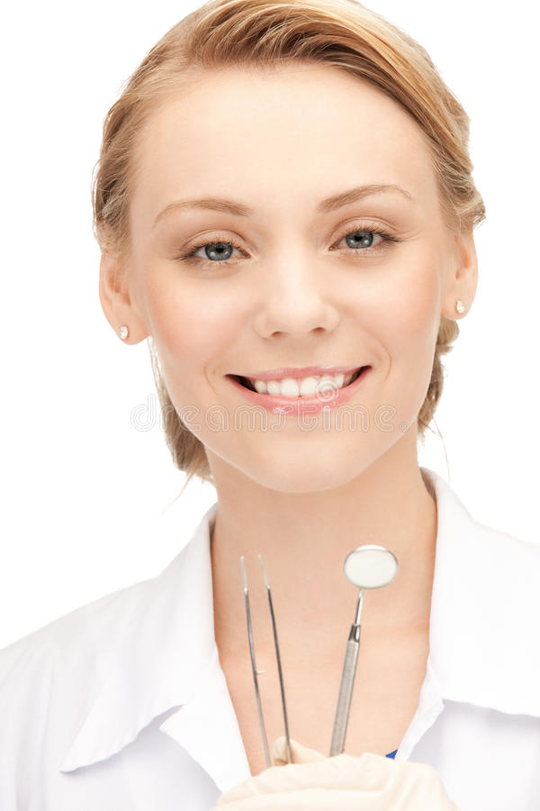Atrakcyjny żeński dentysta z narzędziami obrazy stock