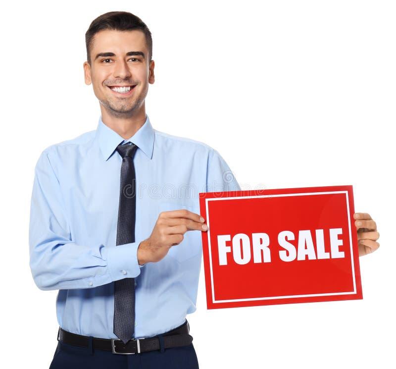 Atrakcyjny agenta nieruchomości mienia ` Dla sprzedaży ` znaka fotografia stock