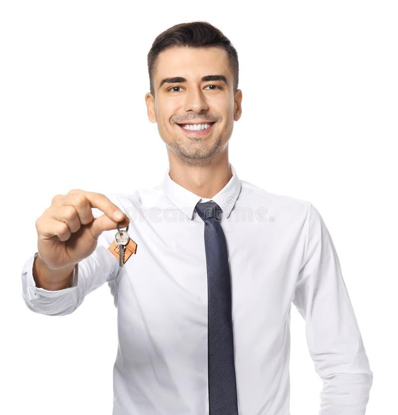 Atrakcyjny agenta nieruchomości mienia klucz obraz stock