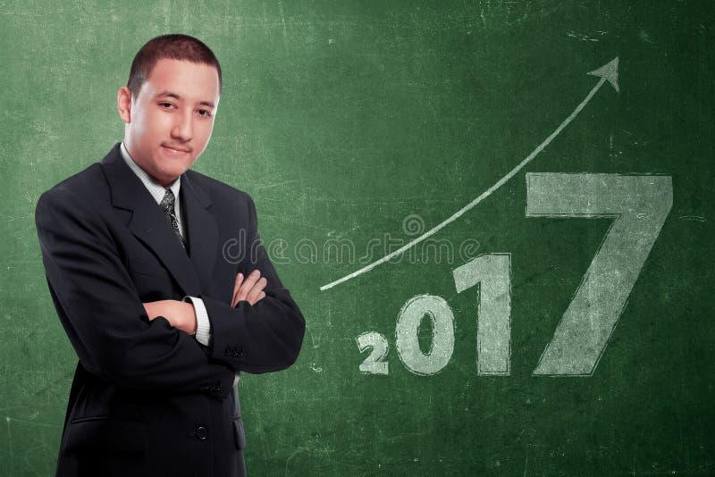 Atrakcyjny azjatykci biznesmen z liczbą 2017 obrazy stock