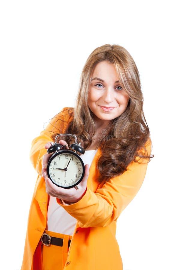 Atrakcyjny bizneswoman z zegarem zdjęcia stock