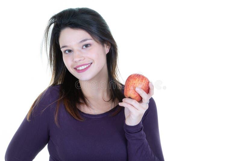 Atrakcyjny młoda kobieta chwyta czerwieni jabłko fotografia royalty free