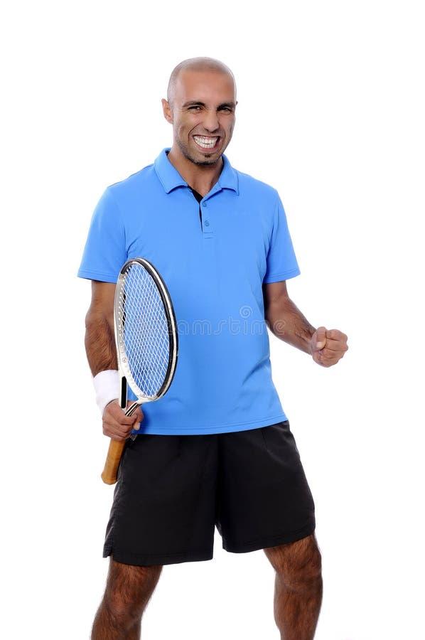 Atrakcyjny młody człowiek bawić się tenisowego portret obraz stock