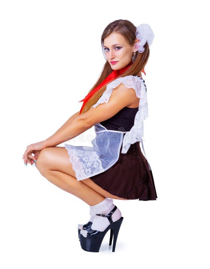 Atrakcyjny striptease tancerz ubierający jako uczennica obrazy stock