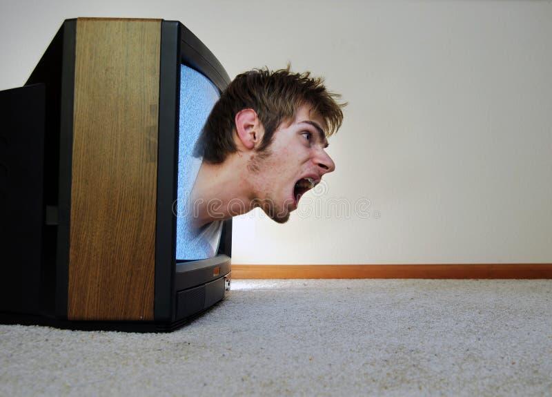 Atrapado dentro de la TV imagen de archivo libre de regalías