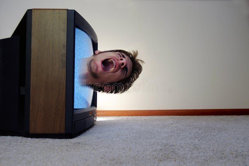 Atrapado dentro de la TV imagenes de archivo