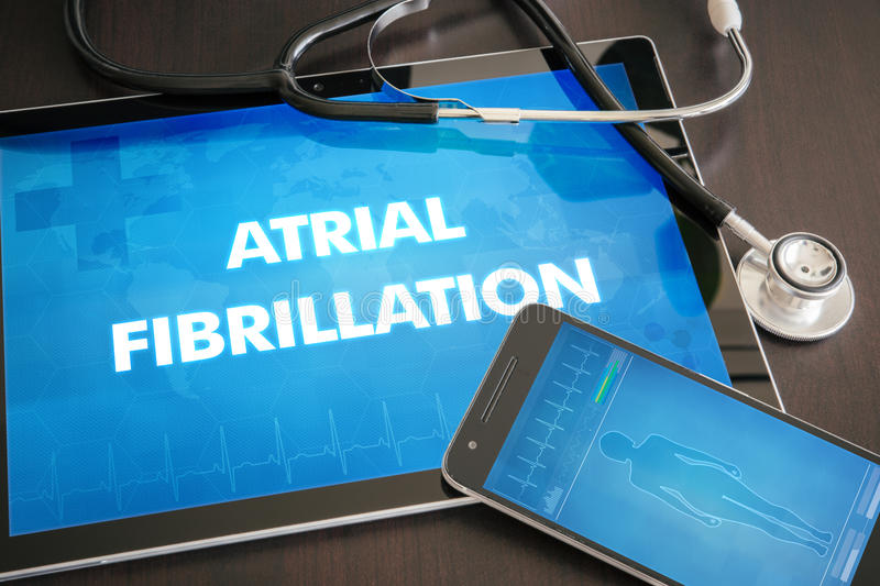 Atrial fibrillation (heart disorder) diagnosis medical concept o. N tablet screen with stethoscope royalty free stock photos