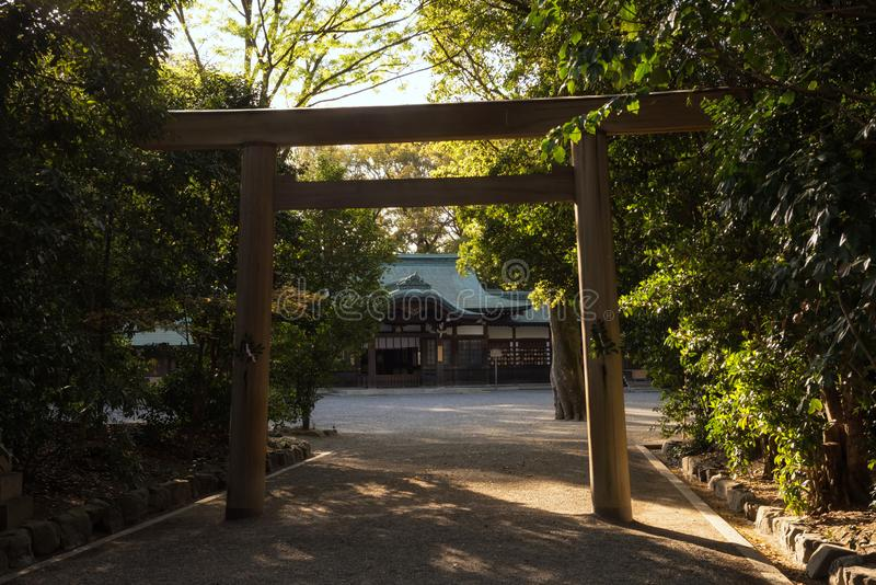 Atsuta Shrine and torii gate at sunset, Nagoya. Big torii gate with Atsuta-jingu Atsuta Shrine during sunset with light shade in Nagoya, Japan. Famous travel royalty free stock photography