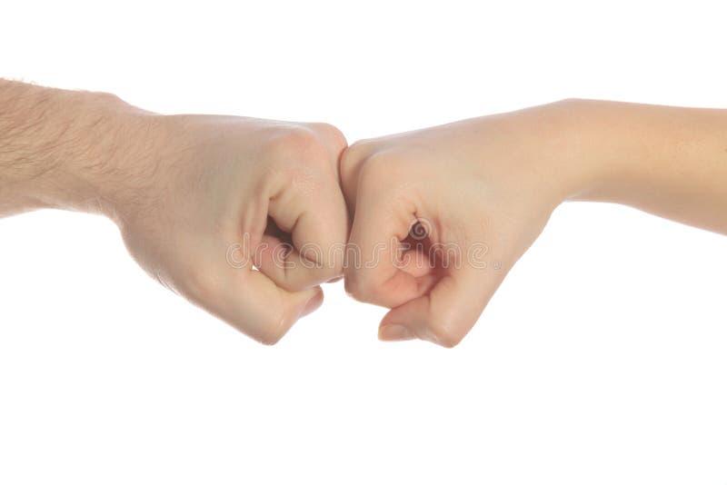 att kollidera hands tillsammans två royaltyfri foto