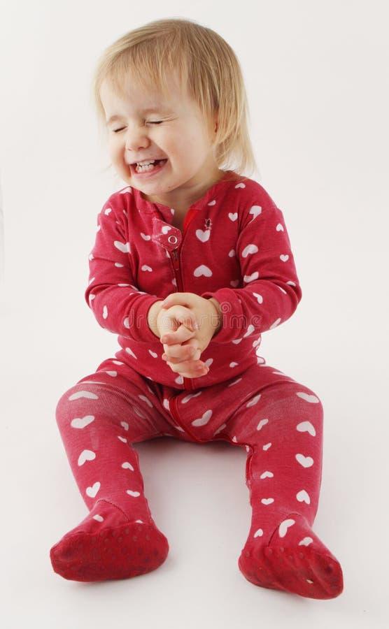 Att le som är lyckligt, behandla som ett barn flickan arkivbilder