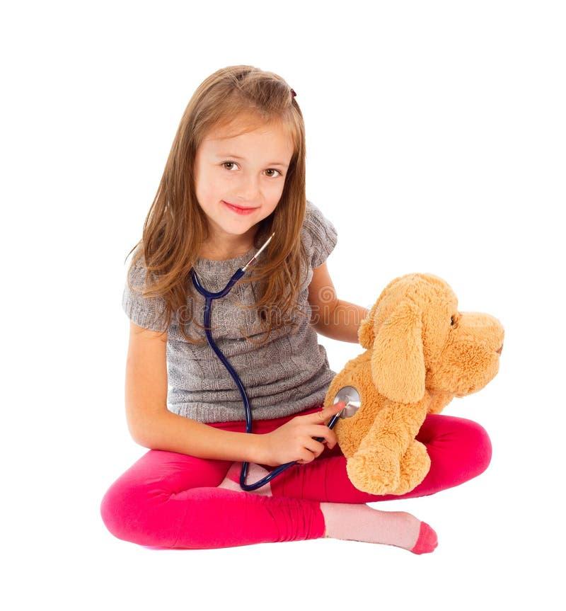 Att leka för liten flicka manipulerar arkivfoto