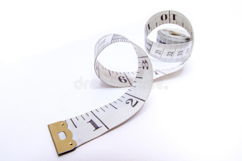 Att mäta tejpar arkivbild