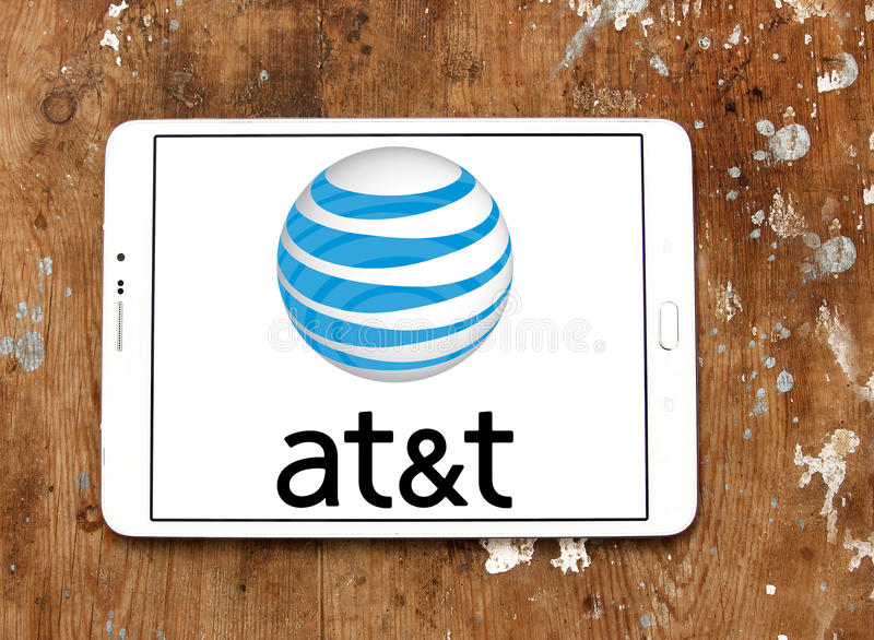 Att mobile operator logo. Logo of att telecom company on samsung tablet on wooden background stock photography