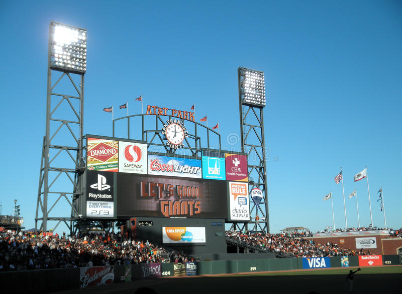 ATT Park HDTV Scoreboard display. ATT Park HDTV Scoreboard in the outfield bleachers displays 'Let's Go Giants' in the final inning to rally the fans. Scoreboard stock photos