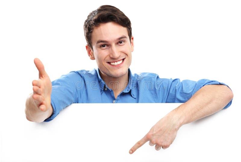 Att peka för man besegrar på den tomma whiteboarden royaltyfria foton