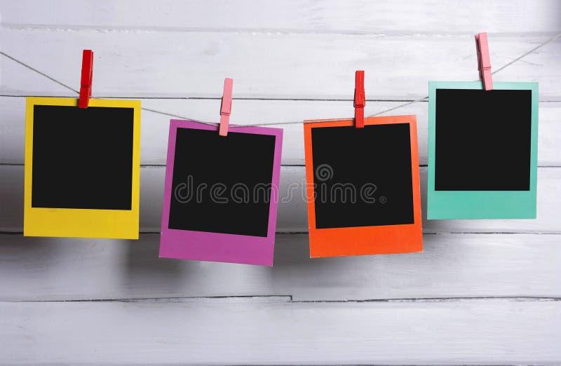 Attaccatura delle foto della polaroid di colore immagini stock libere da diritti