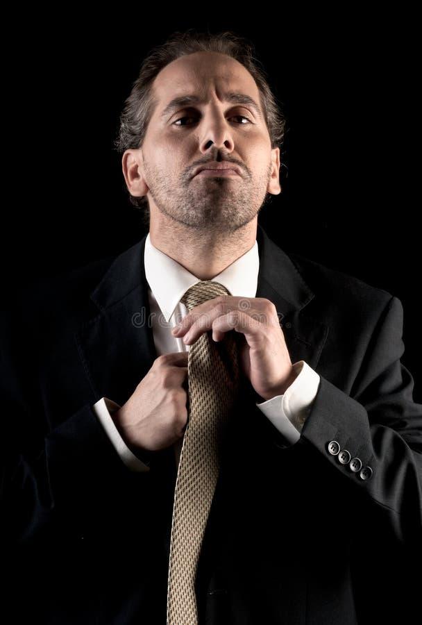 Attache de relation étroite d'homme d'affaires, expression accablée photographie stock