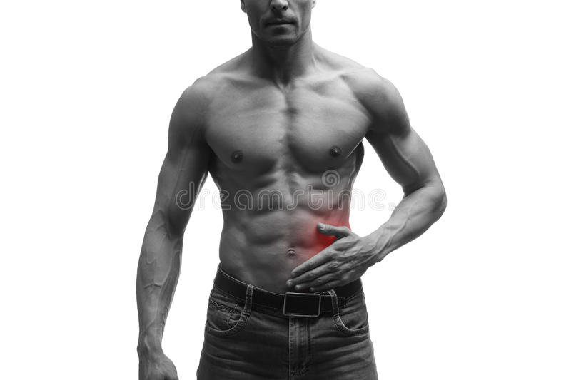 Attack of appendicitis, pain in left side of muscular male body, isolated on white background. Black and white photo with red dot stock photo