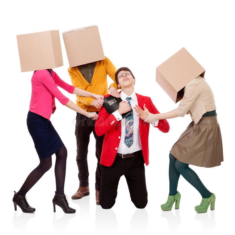 Attack of the pleasures. Three people with boxes in the head that pull a young men with a Bible. FRIENDS, BUSINESS and PLEASURES attack royalty free stock photography