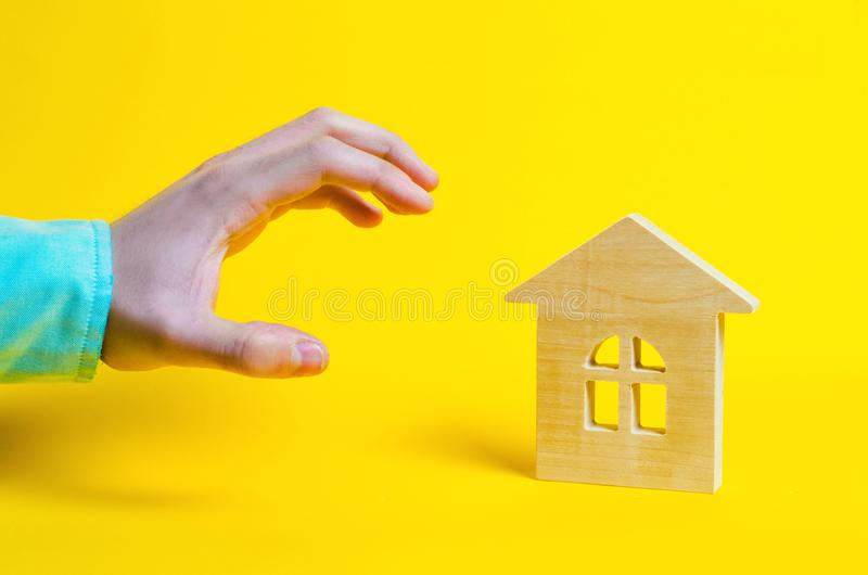 Attack on real estate, seizure of property, the hand wants to take home. Raider seizure. high demand for real estate, hype. yellow. Background royalty free stock photos